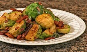 Pan roast Brussels sprouts with toasted pecans and applewood smoked bacon