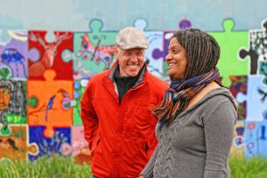Executive Director, Doria Robinson and Chef Nathan share some laughs between takes