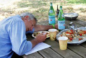 Joe Lamp'l asleep on the table at lunch at Honey Brook Organic Farm