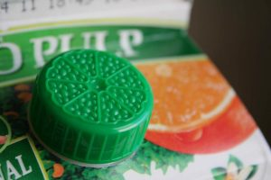 Plastic spout on orange juice carton