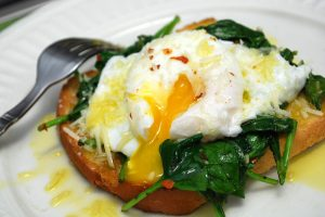 Sauteed fresh spinach with poached egg on toast