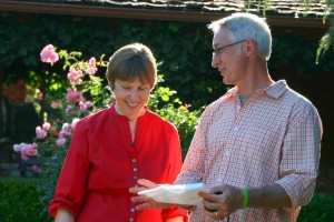 Rosalind Creasy and Joe Lamp'l chat in her front yard garden