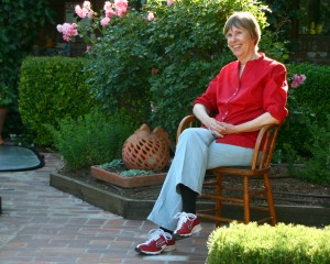 Ros and her red shoes welcome us into her garden